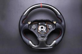 Aston Martin carbon fiber enhanced - custom steering wheel